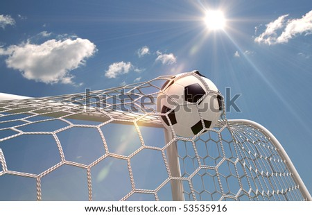 Shot on goal, soccer ball in the net on the sky background - stock photo