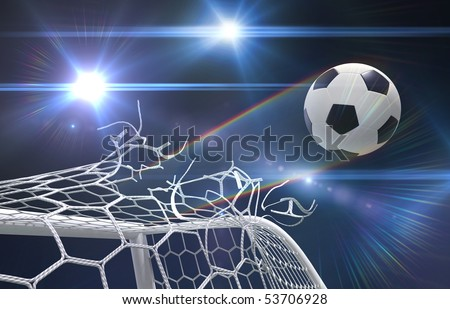 shot on goal, soccer ball tears off the net - stock photo