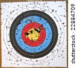 Shot Up Target with Bulls-Eye - stock photo