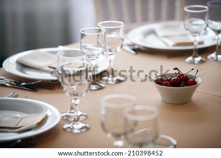 Shot with a dinner table with cherries in a restaurant. - stock photo