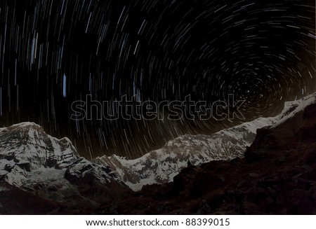 Shot with a long exposure of a rotating stellar sky over Annapurna circus - Nepal, Himalayas - stock photo