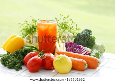 Shot with outdoor tables along with the material vegetable juice - stock photo