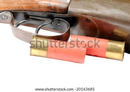 Shotgun and shells isolated on white