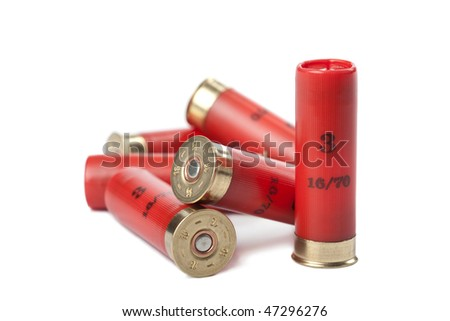 shotgun cartridges isolated over white - stock photo