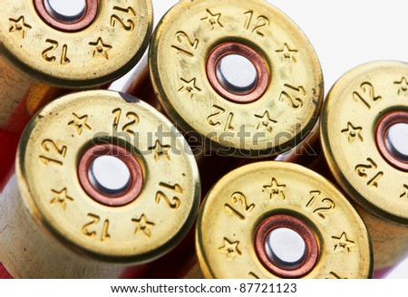 shotgun shells on white background - stock photo