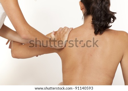 Shoulder massage by a female doctor - stock photo