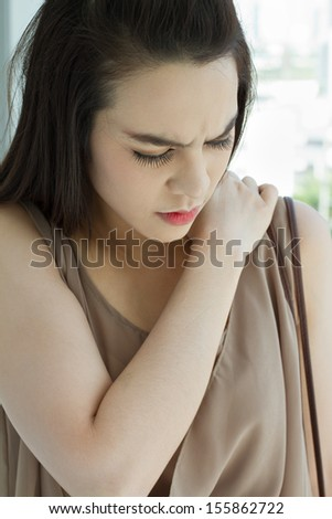 shoulder pain or stiffness, with negative expression - stock photo
