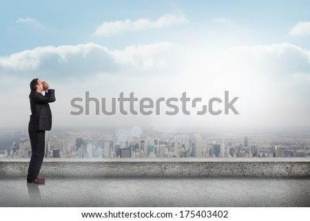 Shouting businessman against balcony overlooking city