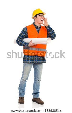Shouting construction worker with paper plan under his arm. Full length studio shot isolated on white.