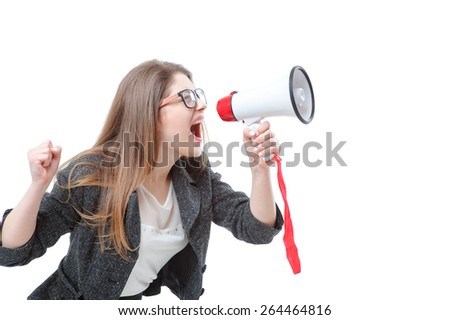 Shouting louder! Studio portrait of young business woman using megaphone. Isolated on white.
