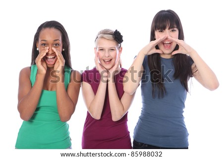 Shouting out loud are three pretty young teenager girl friends a blonde caucasian student, an oriental Japanese and an African American mixed race girl, all with happy smiles. - stock photo