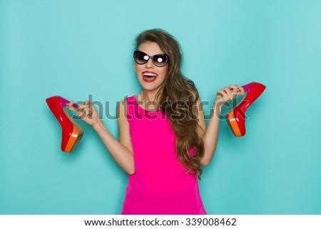 Shouting Woman Holding High Heels - stock photo
