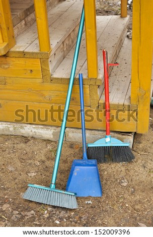 Shovel and broom. An indispensable accessory of a country cottage.