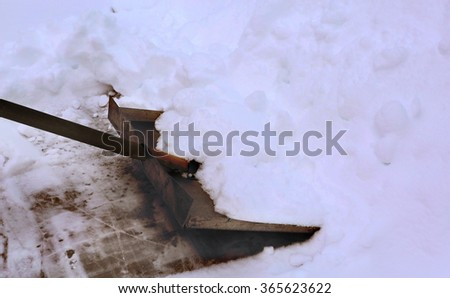 shovel clean snow from open air ice rink surface - stock photo