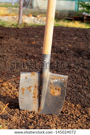 Shovel in field - stock photo