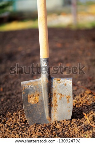 Shovel in field - outdoor - stock photo