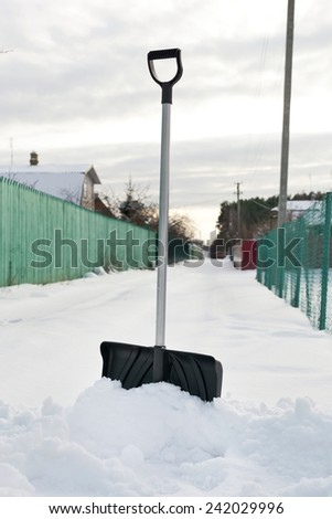 Shovel in snow, ready to removal snow, outdoors - stock photo