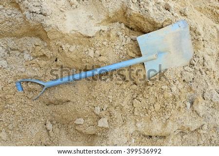 shovel  on the sand - stock photo