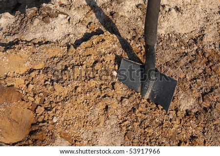 Shovel putted into heap of ground - stock photo