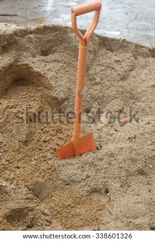 Shovel (spade) and sand for construction - stock photo