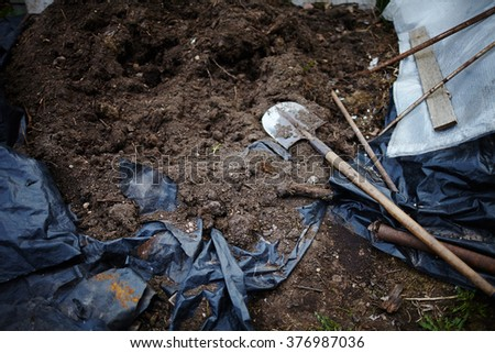 Shovel spoon - tool for digging soil for planting gardening tools and peat on brown background Spade or digging tool - stock photo