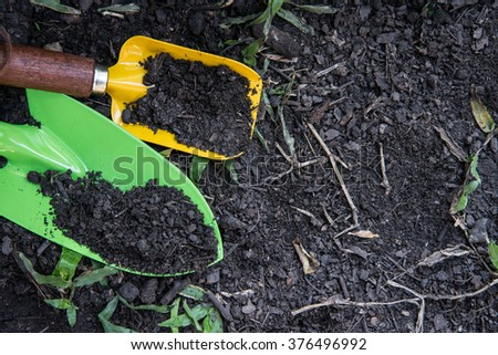 Shovel spoons digging soil - stock photo
