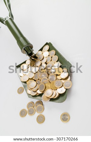 Shovel up money - stock photo