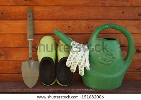 shovel, watering can, rubber overshoes