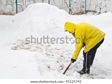 Shoveling snow in winter