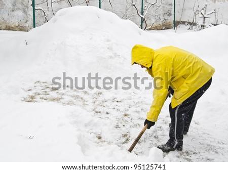Shoveling snow in winter - stock photo