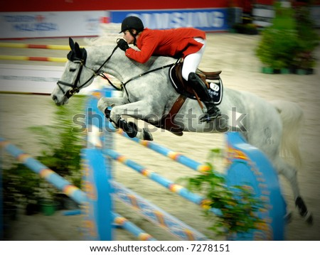 Show jumping in actions during FEI CSI 5 Star KLGrandPrix 2007