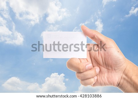 Show white  card in blue sky background  - stock photo