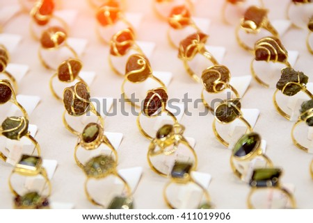 Showcase of a large green stone rings - stock photo