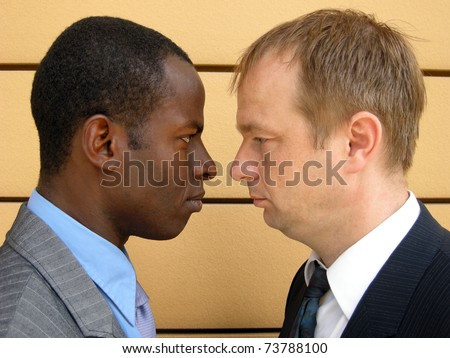 Showdown between two business men - stock photo