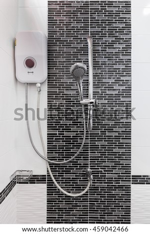 shower and water heater on wall in bathroom