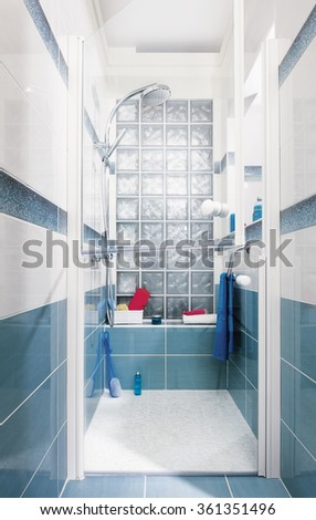 Shower cubicle with glass door divided into two parts