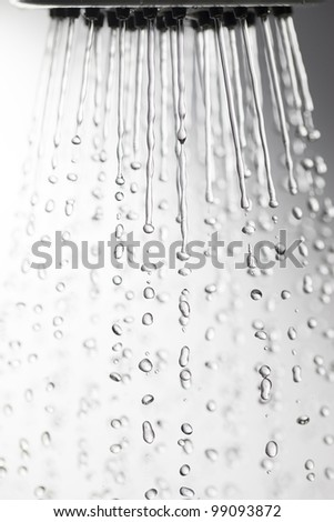 Shower head and falling water drops. - stock photo