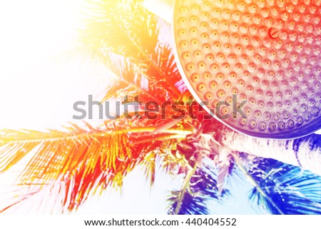 shower head under plam tree on tropical beach with color filters  - stock photo