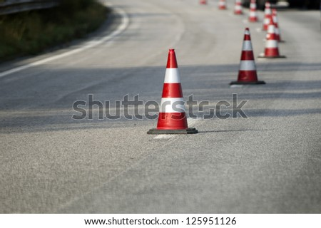 Showing a line of street cones. - stock photo