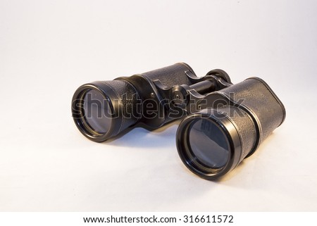 Showing a pair of binoculars on a white background