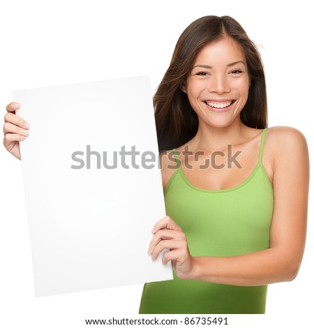 Showing sign woman. Woman showing empty blank paper sign board with copy space for text or design. Fresh and beautiful mixed race Chinese Asian / Caucasian female model  isolated on white background. - stock photo