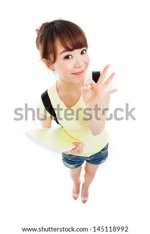 Showing thumb beautiful student high angle shot isolated on white background. - stock photo