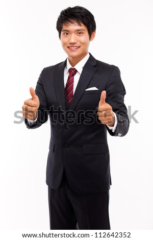Showing thumb young Asian business man. - stock photo