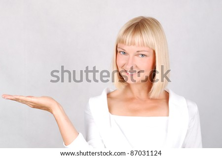 Showing Young Woman/Young Woman gesturing by showing hand