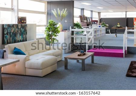Showroom of modern furniture store - stock photo