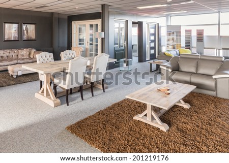 Showroom of modern furniture with tables and chairs - stock photo