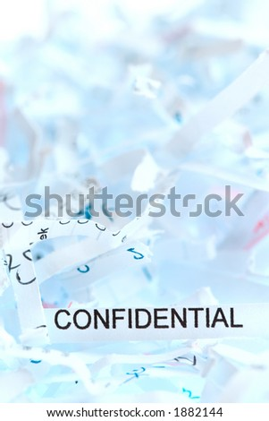 """Shredded paper. Focus on the word """"confidential"""". - stock photo"""