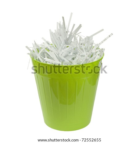 shredded paper for recycling in a green basket on a white background - stock photo