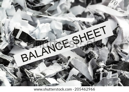 shredded paper tagged with balance sheet, symbol photo for data destruction, budgets and accounting - stock photo