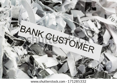 shredded paper tagged with bank customer, symbol photo for data destruction, customer data and banking secrecy - stock photo